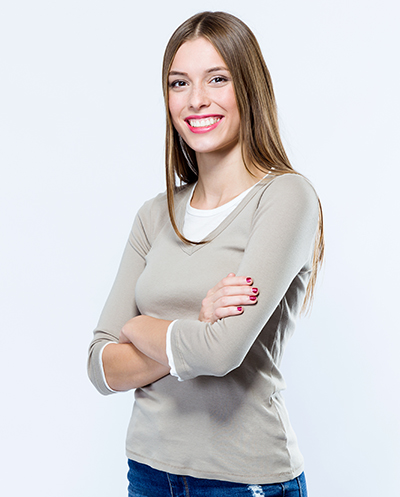 Portrait of beautiful young woman looking at camera over white background.